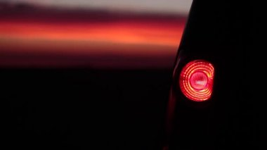 Flashing Car Back Light In The Sunset — Stock Video
