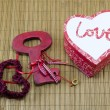 Lace hearts, heart shaped box and a key — Stock Photo #61621667