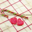 Colorful candy cane and heart shaped candles — Stock Photo #61622143