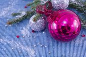 Pink ornament Christmass ball with a fir tree — Stock Photo