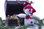 Snowman and a treassure chest on white — Stock Photo
