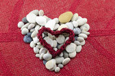 Pebbles shaped into a heart  — Stock Photo
