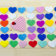 Plenty of colorful hearts on a desk — Stock Photo #62302695