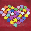 Heart made out of colorful paper flowers — Stock Photo #62470647