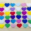 Bunch of colorful hearts on a table — Stock Photo #62470969