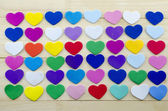 Bunch of colorful hearts on a table — Stock Photo