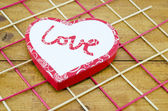 Heart shaped box on a decorated table — Stock Photo