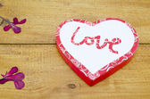 Heart shaped box on a wooden table — Stock Photo