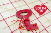 Red wooden vintage key on wooden surface — Stockfoto
