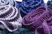 A bunch of  handmade colorful woolen scarfs   — Stock Photo