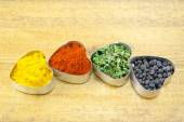 Black pepper, paprika, curry and basil — Stockfoto