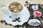 White cup of coffee with decorated foam — Stock Photo