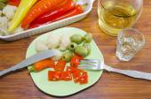 Pickled pepers, cauliflower and olives on a plate — ストック写真