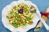 Plate full with cooked peas corn and pepper — Stock Photo