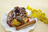 Chocolate muffin with a cherry on top — Stockfoto