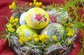 Basket full of handcolored Easter Eggs in decoupage — Stock Photo