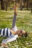 Bunette girl lying in the grass — Stock Photo
