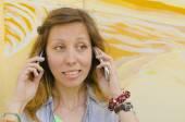 Brunette talking on two mobile phones — Stock Photo