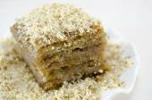 Baklava with grated walnuts on a plate — Stock Photo