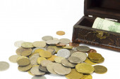 Metal coins with banknotes in the box isolated — Stock Photo