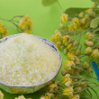 Gren bath salt on with linden flowers on a green backgound — Stock Photo #77559890