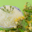 Gren bath salt on with linden flowers on a green backgound — Stock Photo #77559938