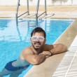 Man chilling in the pool wearing dance party glasses — Stock Photo #79024712