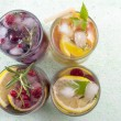 Four non alcoholic fruit cocktails arranged on the green table t — Stock Photo #80223432