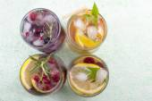 Four non alcoholic fruit cocktails arranged on the green table t — Stock Photo
