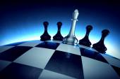 Chess king with four pawns on spherical checker surface — Stock Photo