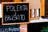 Blackboard outside an italian restaurant — Stock Photo