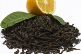The leaves are dried and twisted black Ceylon tea closeup. — Stock Photo