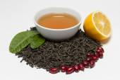 Ceylon black tea, rose, lemon and tonic brewed of them. — Stock Photo