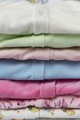 Clothes for children in the stack. — 图库照片