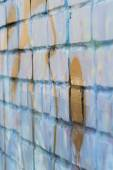 Brick wall painted with graffiti in blue. — Stock Photo