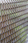 Background in the form of a metal fence mesh netting. — Foto Stock