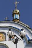 Old forged lantern on the background of the Orthodox church. — Stock Photo