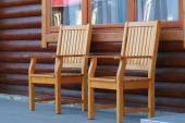 Two wooden chairs standing on the terrace. — Foto de Stock