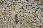 Wall made of pieces sandstone protruding clump. — Stock Photo