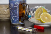 Table with tools for the treatment of colds, flu and acute respiratory disease. — Stock Photo