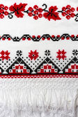 Pattern embroidered on the towel with red and black thread. — Stock Photo
