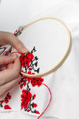 Hands girls embroider pattern using the frame. — Stock Photo