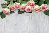 Roses on a wooden background  — Stock Photo