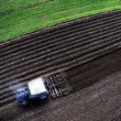 Aerial top view of tractor with plough — Stock Photo #61325227