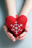 Christmas heart in child hand — 图库照片