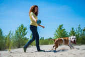 Girl with a dog on the nature — Stock Photo