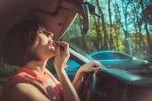 The girl behind the wheel of lipstick — Stock Photo