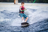 A child riding in the Wakeboarding — Stock Photo