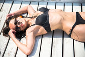 The slender girl in a bathing suit — Stock Photo