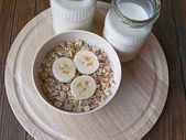 Oat porridge with bananas and yogurt — Stock Photo